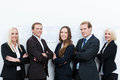 Happy professional team standing with folded arms made of two businessmen and three businesswomen against a white wall Stock Photos