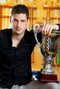 Happy proud winner man with big trophy silver cup Royalty Free Stock Photo