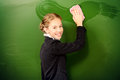 Happy pupil smiling schoolgirl washes the blackboard in classroom education Royalty Free Stock Images