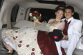 Happy Quinceanera Sitting In Limousine With Partner Royalty Free Stock Image