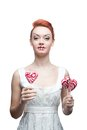Happy red-haired girl holding candy Stock Photos