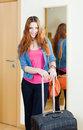 Happy red haired woman with luggage leaving her home Stock Images