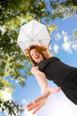 Happy red haired woman with umbrella outdoors Royalty Free Stock Photo