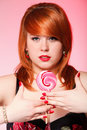 Happy redhair woman with lollipop candy
