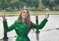 Happy redhead enjoying the rain drops in the park Royalty Free Stock Photo