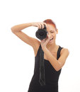 A happy redhead photographer shooting with a camera Stock Images