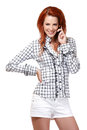 Happy redhead woman making a phone call Stock Photography