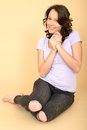 Happy relaxed pleased attractive young woman portrait a dslr royalty free image a sitting on floor looking at camera smiling Royalty Free Stock Photos
