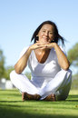 Happy relaxed senior sitting in park II Royalty Free Stock Image