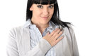 Happy Relaxed Woman Smiling with Hand on Chest Royalty Free Stock Photo