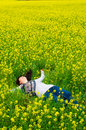 Happy and relaxed woman very young on the flower field field of barbarea vulgaris true relaxation Stock Image