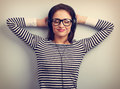 Happy relaxing young woman in headphones listening the calm musi