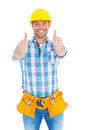 Happy repairman gesturing thumbs on white background Royalty Free Stock Photo