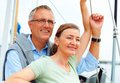 Happy retired couple on a sailboat Royalty Free Stock Photo