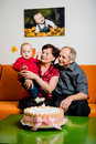 Happy retirement first birthday of grandchild grandparents with their small celebrating at home Royalty Free Stock Photo