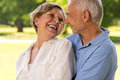 Happy retirement senior couple laughing together hugging and smiling at each other Royalty Free Stock Photography