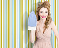 Happy retro housewife holding iron doing ironing with smile home interior wallpaper background Stock Images