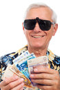 Happy rich elderly man with money Royalty Free Stock Photo