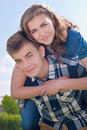 Happy riding Young couple hugging & blue sky Stock Images