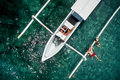 Happy romantic couple in love relax near a yacht in the sea while honeymoon