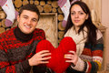 Happy romantic couple with a red heart Royalty Free Stock Photo