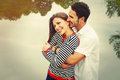 Happy romantic wide smile couple in love at the lake outdoor on Royalty Free Stock Photo