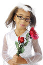 Happy rose carrier a dressy young elementary girl happily carrying red roses on a white background Royalty Free Stock Photo