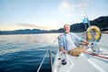 Happy sailing man boat carefree portrait of mature retired on ocean at sunrise Stock Photo
