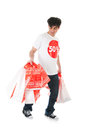 Happy with sale young man is agitated by the many bags Stock Photos