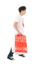 Happy with sale young man is agitated by the many bags Stock Photo