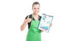 Happy saleswoman holding clipboard with charts Royalty Free Stock Photo