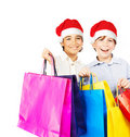 Happy Santa boys with gifts Royalty Free Stock Image