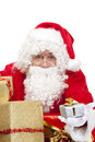 Happy Santa Claus with Christmas gifts Stock Photo