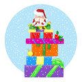 Happy Santa Claus sits on a large pile of gifts Royalty Free Stock Image