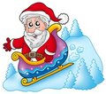 Happy Santa Claus on sledge Stock Photo