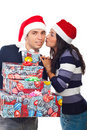 Happy Santa man being kissed by woman Royalty Free Stock Images