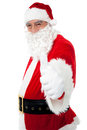 Happy Santa showing thumbs up to camera Royalty Free Stock Photography