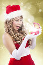 Happy santa woman receive luxury christmas gift Stock Photo