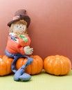 Happy Scarecrow Hugging A Pumpkin Royalty Free Stock Photo