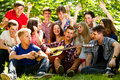 Happy school friends singing by guitar ggroup of young people in unison Stock Photo