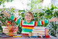 Happy school kid boy with glasses and student stuff Royalty Free Stock Photo