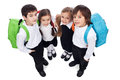 Happy school kids with back packs Royalty Free Stock Photo