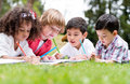 Happy school kids coloring group of outdoors looking Royalty Free Stock Images