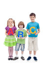 Happy school kids holding large abc letters Royalty Free Stock Image