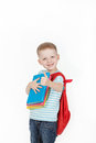 Happy schoolboy with backpack and books isolated on white background boy holds a stack of behind red Stock Images