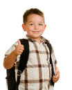 Happy schoolboy wearing backpack giving thumbs up Royalty Free Stock Photography