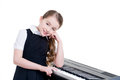 Happy schoolgirl with electric piano. Royalty Free Stock Photography