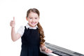 Happy schoolgirl with electric piano. Royalty Free Stock Photo