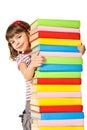 Happy Schoolgirl holding pile of books