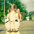 Happy schoolgirl standing on the road Royalty Free Stock Photo